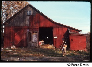 Child walking past the barn, Packer Corners commune