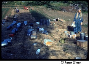 Buckets laid out in a field for harvest, Tree Frog Farm commune