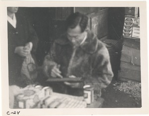 Shopkeeper calculating sale with abacus