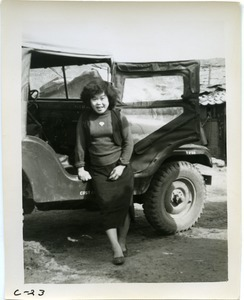Young woman with jeep