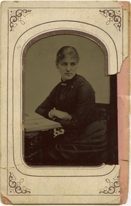 Alice Thacher Channing: half-length studio portrait, seated at a table
