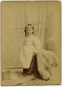 Alice Channing: full length studio portrait at three years old, with fur rug