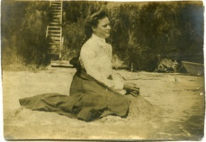 Alice Channing: portrait, seated on the sand