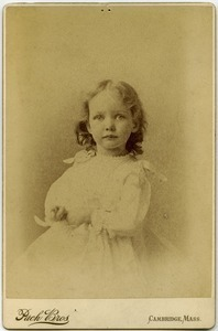 Alice Channing: half-length studio portrait with hands in lap