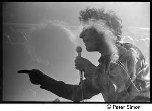 Abbie Hoffman speaking at the Moratorium (double exposure)