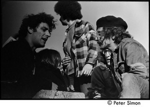 Abbie Hoffman (left) talking with other protesters