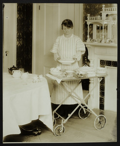 Woman with a tea wagon, location unknown, undated