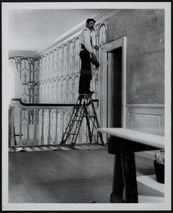 Worker on ladder installing wallpaper, Hamilton House, South Berwick, Maine, 1898