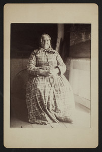Full-length portrait of Mrs. Roberts, seated, facing front, Wellfleet, Mass., undated