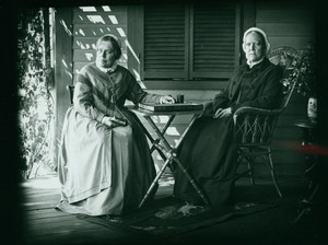 Double portrait of Misses Frances Greely Stevenson and Martha Curtis Stevenson, seated on chairs on a porch, facing front, Manchester, Mass., 1890