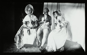 Group portrait of Elinor Curtis and two unidentified people, seated on chairs, facing front, dressed in costumes, location unknown, undated