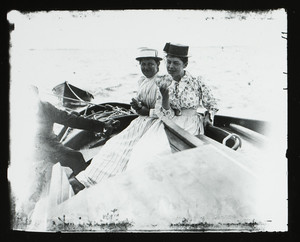 Elinor Curtis and Bessie P. eating on a boat, Manchester, Mass., undated