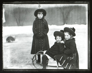 Two girls on sled