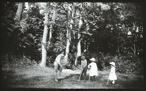 Children playing croquet, location unknown, 1888