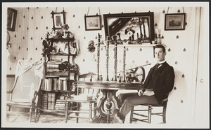 Young man with musical instruments on table