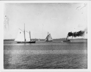 Lantern slide depicting pilot schooner Varuna with tugboat and sloop, Boston Harbor, Mass., undated