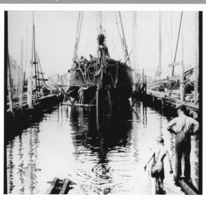 Marine railway with small schooner and boys, location unknown, undated