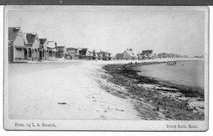 Beach with cottages and a large rowboat off shore, Brant Rock, Mass., undated