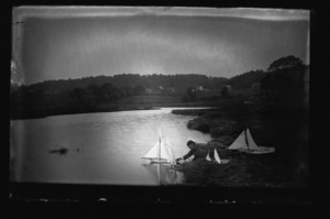 Two Curtis boys sailing model yachts, Manchester, Mass., undated