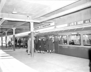 Orient Heights Station with passengers boarding inbound trains
