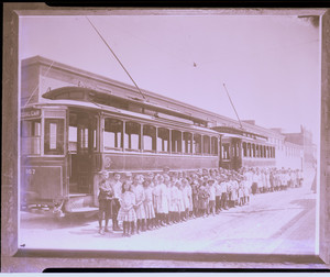 Twenty-five foot box cars at North Point, C. H. School children's outing