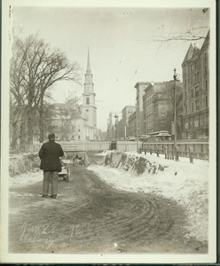 Subway construction on Tremont St., Boston, Mass., with unidentified man in foreground facing Park St. Church