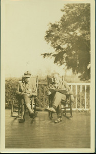 Arthur Lyman and Kenneth Parson, Jr., seated on Bonney Hall Plantation porch, S.C.