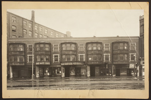 Exterior view of commercial buildings and storefronts between 187 and 195 Massachusetts Avenue