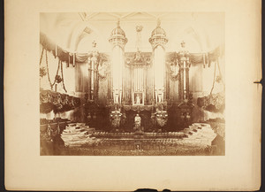 """Close-up view of the """"Great"""" pipe organ and platform in Boston Music Hall, as decorated for Charles Sumner's memorial service"""