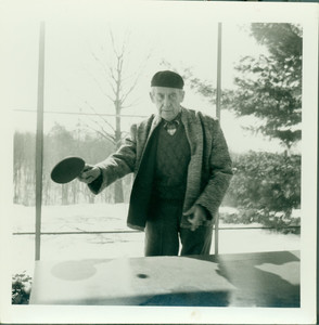 Walter Gropius playing ping pong, Gropius House, Lincoln, Mass., undated