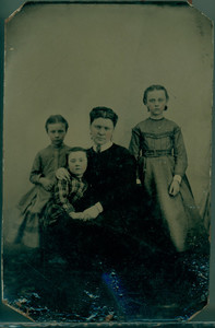 Group portrait of Mary G. (Mollie)Tucker and her children, location unknown, undated