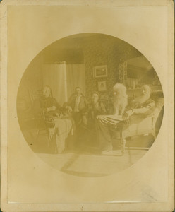 Informal group portrait of the Tucker family and their dog, unknown location, undated
