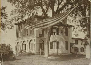 Exterior view of Castle Tucker with American flag in foreground, Wiscasset, Maine, undated