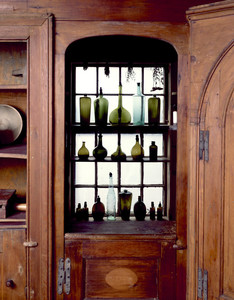 Antique bottles in window of Pine Kitchen, Beauport, Sleeper-McCann House, Gloucester, Mass.