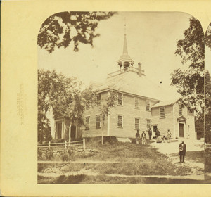 Exterior view of Old Ship Church, Hingham, Mass., with Rev. Joseph Richardson in foreground