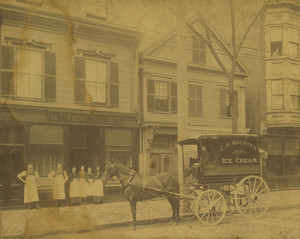 Ice cream cart and employees of Charles H. Wachter, Confectioners, standing in front of the Wachter store at 187 West Broadway, South Boston, Mass.