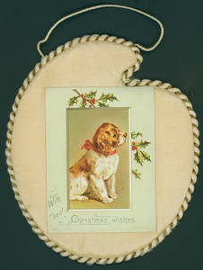 Christmas card, showing a dog and holly, undated