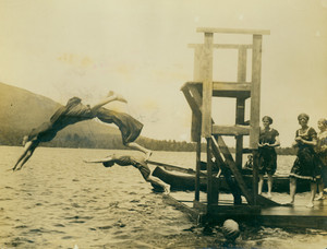 Women campers diving at the lake