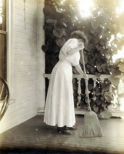 Woman sweeping a porch properly