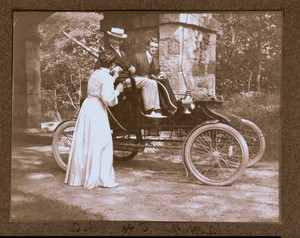 """A.H.B., C.H., and Irene Curtis"" with car, Manchester, Mass."