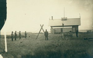 Men hoisting a man up to a rooftop look-out station with rope and pulley, Life Saving Station, Biddeford Pool, Me.