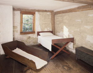 Chamber showing bed and cradle, Coffin House, Newbury, Mass.