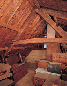 Attic showing stored trunks and furniture, Coffin House, Newbury, Mass.