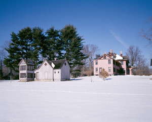 Outbuildings and house in snow, Roseland Cottage, Woodstock, Conn.