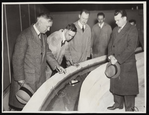 Army engineers study the model of the Cape Cod Canal