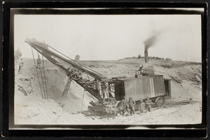 Workers supervise the dry digging process for the Cape Cod Canal