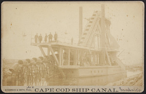 Cape Cod Ship Canal, cabinet card of a bucket dredge with men standing on the upper deck, Sandwich, Mass.