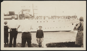 A boy poses in front of the Presidential Yacht