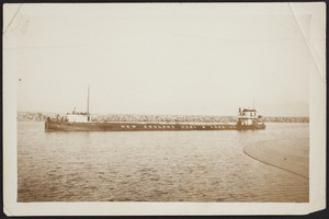 The first cargo ship enters the Cape Cod Canal