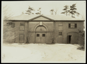 Exterior view of the Lyman Estate carriage barn in winter